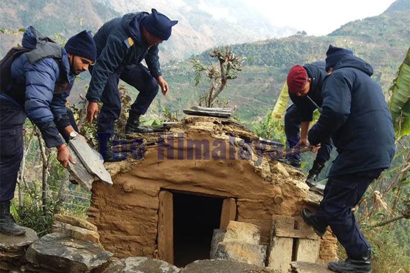 Police personnel are seen destroying a chhau shed in Budhiganga Municipality-8 of Bajura district, on Thursday, January 16, 2020. Photo: Prakash Singh/THT