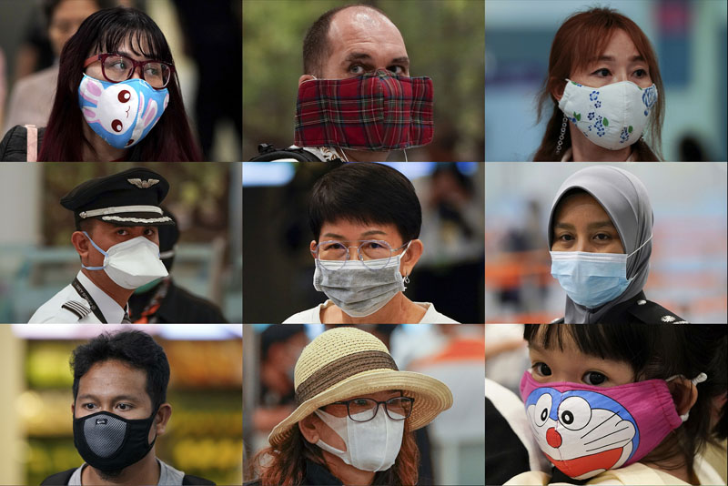 In this combination of photos, people wear various masks as they wait at an immigration counter at an airport terminal in Sepang, Malaysia, outside Kuala Lumpur, Wednesday, Jan 29, 2020. Photo: AP