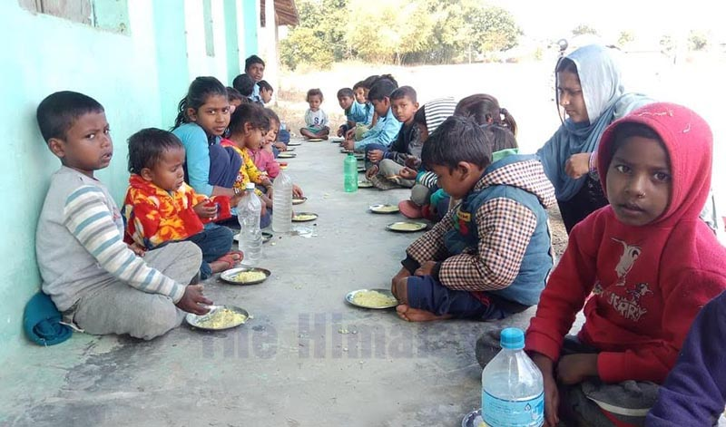 Children at Dalit Basic Level School having day meal, in Siraha, on Monday, January 20, 2020. Photo: THT