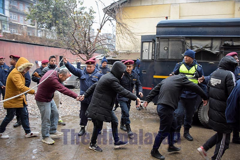Detained Chinese nationals being taken to Tribhuvan International Airport for deportation to China, on Wednesday, January 8, 2020. Photo: Naresh Shrestha/THT