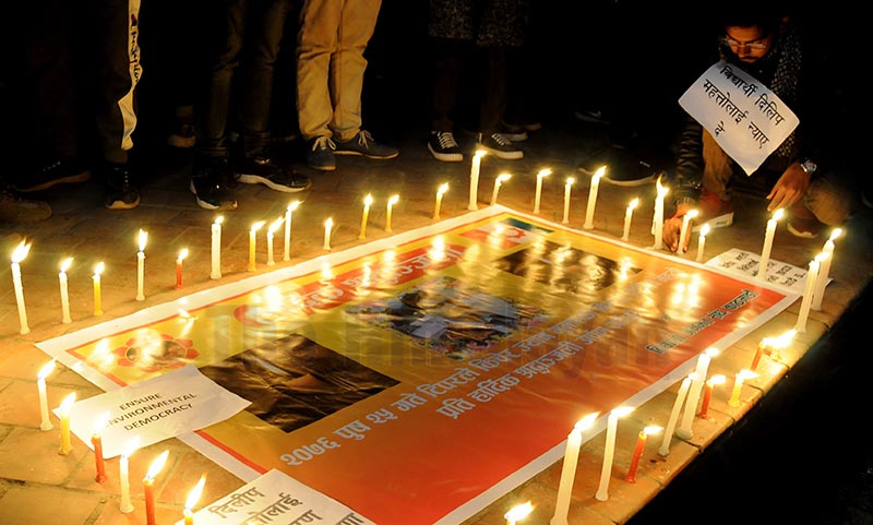 Youths lighting candles for Dilip Kumar Mahato who was killed for protesting against sand mining on the banks of the Aurikhola in Mithila Municipality on Friday, at Maitighar Mandala, Kathmandu, on Saturday. Photo: Bal Krishna Thapa / THT