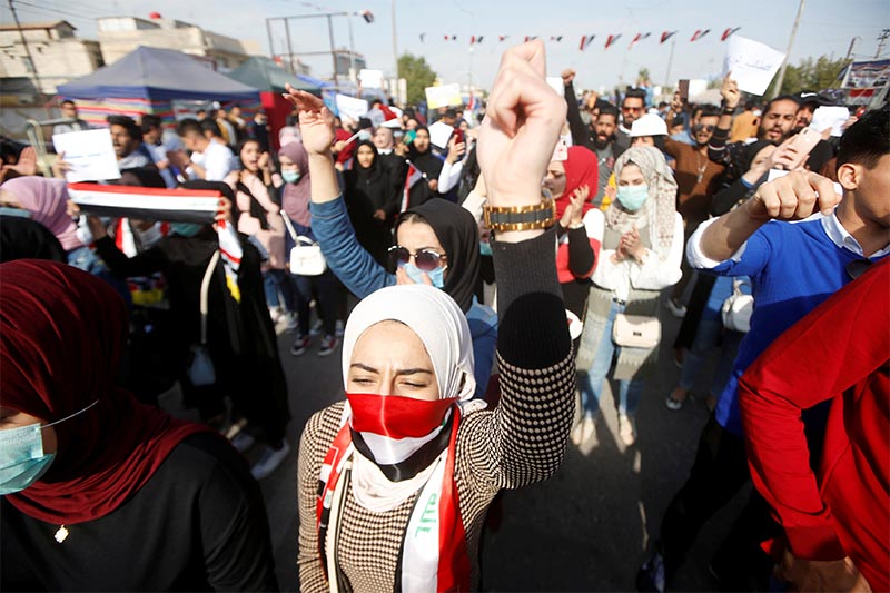 University students attend a protest against the US and Iran interventions, in Basra, Iraq, on Wednesday, January 8, 2020. Photo: Reuters