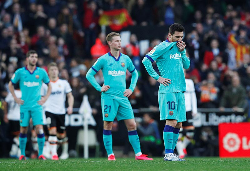 Barcelona's Lionel Messi and Frenkie de Jong look dejected after Maxi Gomez scored Valencia's second goal during the La Liga Santander match between Valencia and FC Barcelona, at Mestalla, in Valencia, Spain, on  January 25, 2020. Photo: Reuters