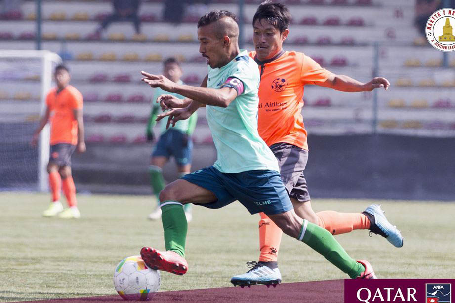 Saraswati Youth Club player (blue jersey) tries to dribble past HSC player during Qatar Airways Martyr's Memorial 'A' Division League, in Lalitpur, on Tuesday, January 28, 2020. Photo: ANFA/Facebook