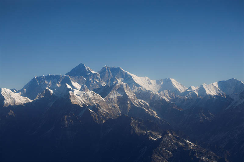 Mount Everest, the world's highest peak, and other peaks of the Himalayan range are seen through an aircraft window during a mountain flight from Kathmandu, on Wednesday, January 15, 2020. Photo: Reuters
