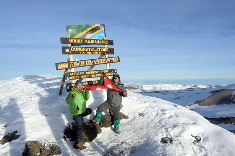 Ngima Lama Sherpa of Adventure Small World Treks & Expeditions and Pasang Sherpa of Trekking Tourism & Adventure Pvt Ltd standing atop Mt Kilimanjaro, on December 25. Photo: Ngima Lama Sherpa