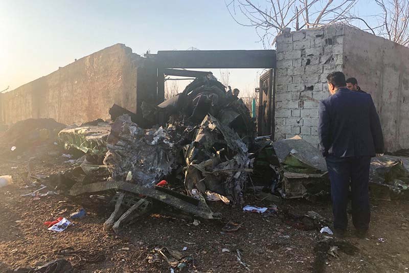 Debris is seen from a plane crash on the outskirts of Tehran, Iran, Wednesday, Jan. 8, 2020. A Ukrainian aeroplane carrying at least 170 people crashed on Wednesday shortly after takeoff from Tehranu2019s main airport, killing all onboard, state TV reported. Photo: AP