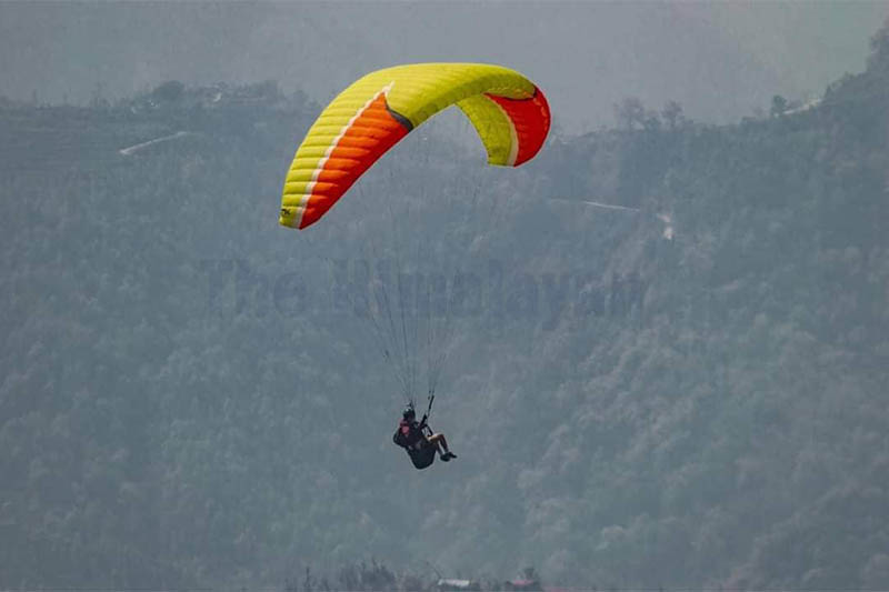 A tourist is seen paragliding from Gurunche Danda of Bandipur Rural nMunicipality, in Tanahun, on Wednesday, January 22, 2020. Photo: Madan Wagle/THT