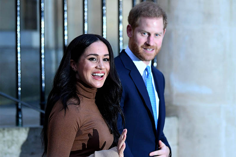 FILE PHOTO: Britain's Prince Harry and his wife Meghan, Duchess of Sussex react as they leave after their visit to Canada House in London, Britain  January 7, 2020. Photo: Reuters