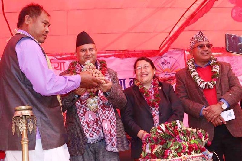 Secretary of Janaknagar Community Homestay Hariram Tharu welcoming Province 5 Chief Minister Shankar Pokhrel with a potato cap at the inauguration programme of Visit Nepal 2020, in Bardiya, on Wednesday, January 1, 2020. Photo: THT