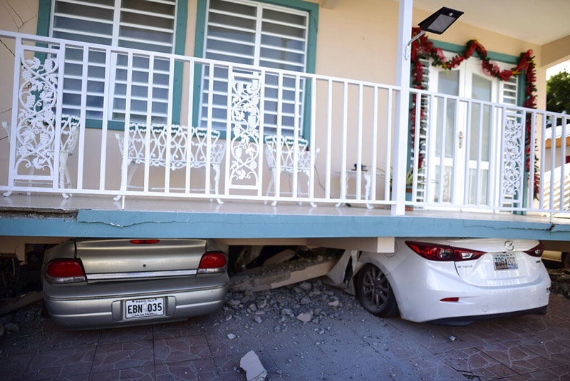 Cars are crushed under a home that collapsed after an earthquake hit Guanica, Puerto Rico, Monday, January 6, 2020. A 5.8-magnitude quake hit Puerto Rico before dawn Monday, unleashing small landslides, causing power outages and severely cracking some homes. There were no immediate reports of casualties. Photo: AP