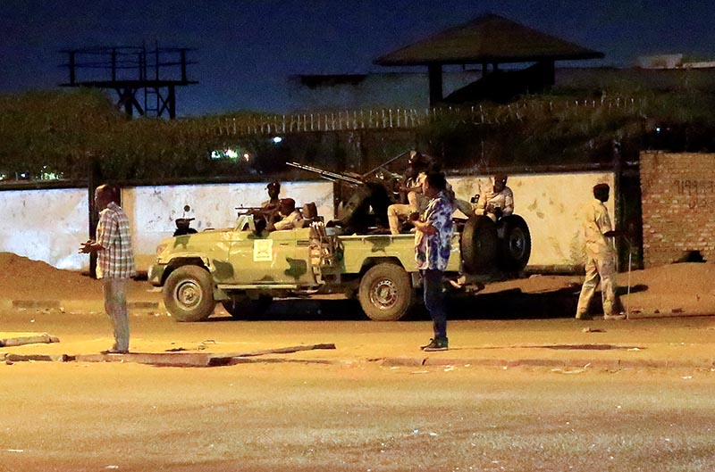 Members of the Sudanese Rapid Support Forces (RSF) are seen near the area where gunmen opened fire outside buildings used by Sudan's National Intelligence and Security Service (NISS) in Khartoum, Sudan January 14, 2020. Photo: Reuters