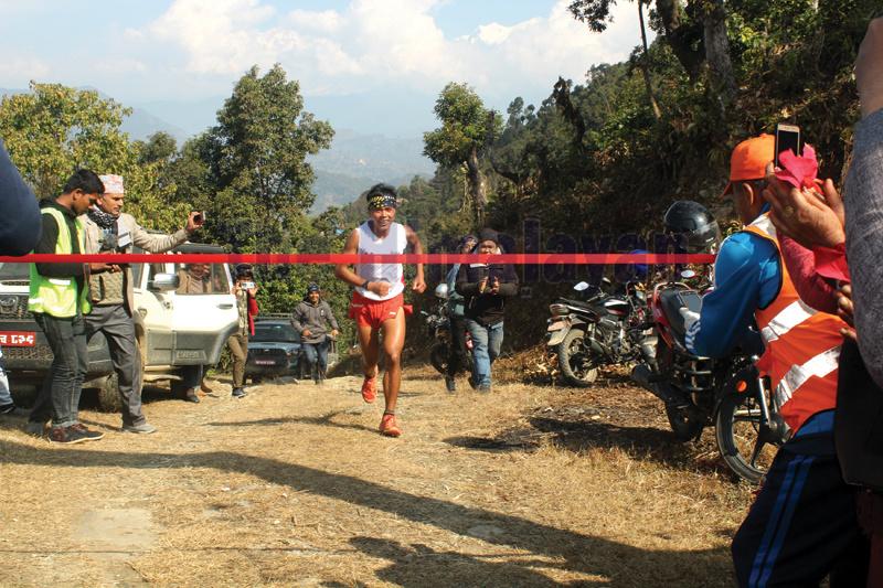 Suman Kulung reaches the finishing line on his way to winning the third Byasnagar Ultra Marathon in Tanahun on Thursday. Photo: Madan Wagle/THT