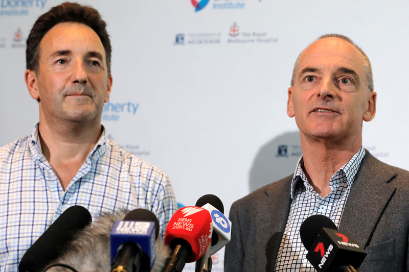 (L-R) The Royal Melbourne Hospital's Dr Julian Druce, Virus Identification Laboratory Head at the Doherty Institute and Dr Mike Catton, Deputy Director of the Doherty Institute address media to announce having successfully grown the Wuhan coronavirus from a patient sample in Melbourne, Victoria, Australia, January 28, 2020. Photo: Reuters