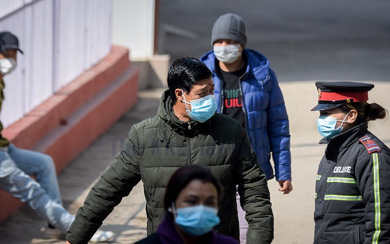 Pedestrians wearing masks as a protective measure as they walk on a street in Kathmandu, on Monday. Nepalis have become wary after coronavirus was confirmed in the country. Photo: Naresh Shrestha/THT
