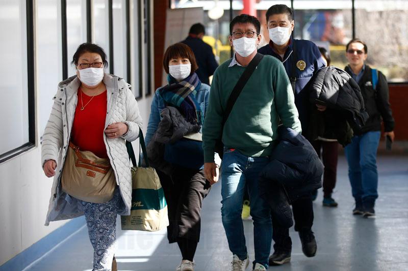 Passengers wear face masks as they arrive at Tribhuvan International Airport, in Kathmandu, on Tuesday, January 28, 2020. Photo: Skanda Gautam/THT