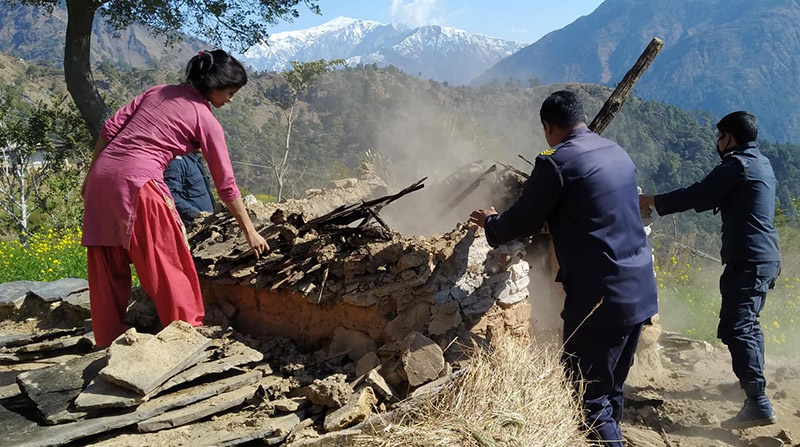Locals along with security personnel destroying 'chhau' huts in Achham district. Photo: Prakash Singh/THT