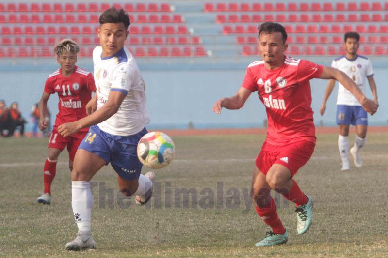San Miguel Machhindrau2019s Rejin Subba (left) vies with Ruslan TSCu2019s Nishan Khadka during their Qatar Airways Martyrs Memorial A Division League match in Kathmandu on Monday. Photo: Udipt Singh Chhetry / THT