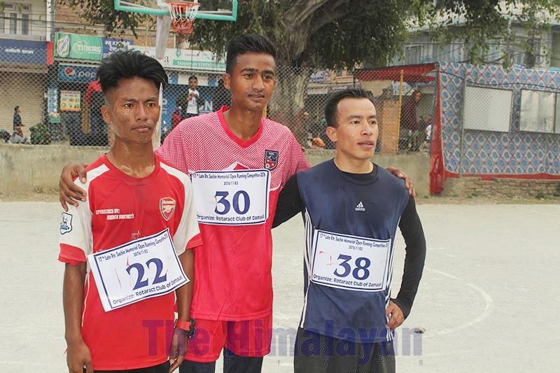 Winner, second and third finishers of 17th Late Rotarian Sachin Memorial Open Running Competition u2014  Suraj Dura, Anil Majakoti and Pramish Gurung u2014 pose for photo, after the competition, in Tanahun district, on Saturday, February 15, 2020. Photo: Madan Wagle/THT