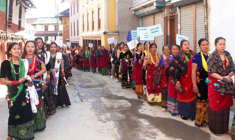 People dressed in traditional Magar attire take part in a march organised by Nepal Magar Association, Baglung, to mark the 38th Magar Day on Thursday, February 27, 2020. Photo: Rastriya Samachar Samiti