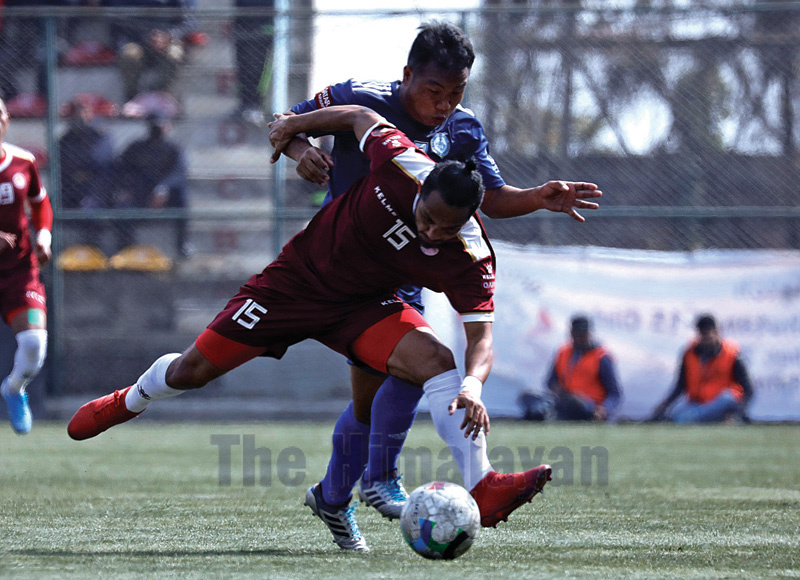 Sankatau2019s Bishnu Sunuwar (front) and Ruslan TSCu2019s Lalrammawia vie for the ball during their Qatar Airways Martyrs Memorial A Division League match in Lalitpur on Friday. Photo: THT