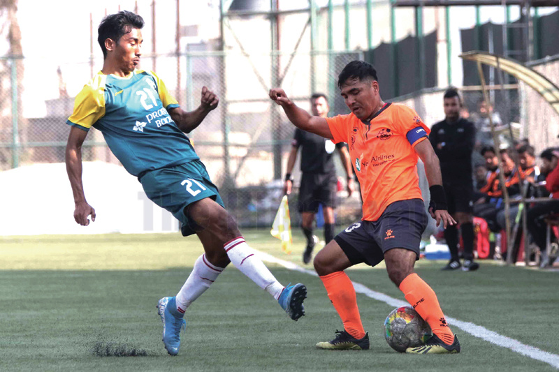 Man Bahadur Tamang (right) skipper of Himalayan Sherpa Club dribbles the ball against Sujit Budathoki of Jawalakhel Youth Club during their Qatar Airways A Division League match at ANFA grounds in Lalitpur on Wednesday. Photo: Udipt Singh Chhetry/THT