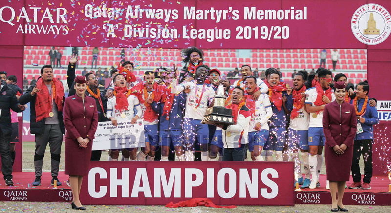 Players and officials of Machhindra Football Club celebrate victory with winner's trophy during prize distribution ceremony of Qatar Airways Martyr's Memorial A Division League at Dasharath Stadium in Kathmandu on Saturday.Photo: Udipt Singh Chhetry/THT