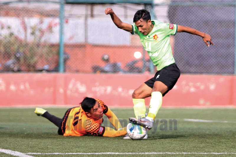 Sanotsh Tamang (right) of Tribhuvan Army Club dribbles the ball against Raju Yogi goalkeeper off Nepal APF Club during their Qatar Airways Martyr's Memorial A Division League match at ANFA ground, Satdobato in Lalitpur on Thursday. Photo: Udipt Singh Chhetry/THT