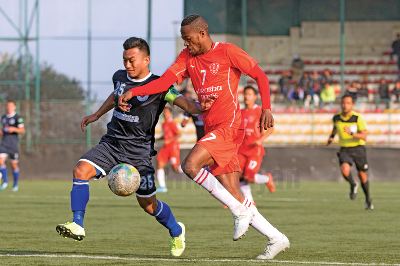 Fode Fofana of Prabhu JYC vies for the ball with NIBL Friends Club skipper Saroj Younjan Lama (left) during their Qatar Airways Martyrs Memorial A Division League match at the ANFA Complex grounds in Lalitpur on Saturday. Photo Courtesy:nANFA