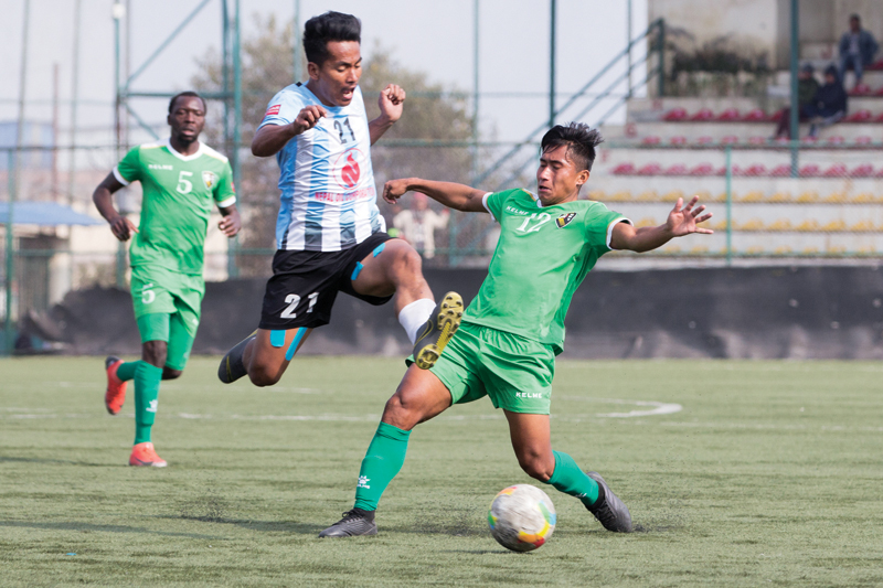 NOC MMCu0092s Bimal Rana vies for the ball with NRTu0092s Nabin Gurung (right) during their Qatar Airways Martyrs Memorial A Division League match at the ANFA Complex grounds in Lalitpur on Sunday. Photo courtesy: ANFA