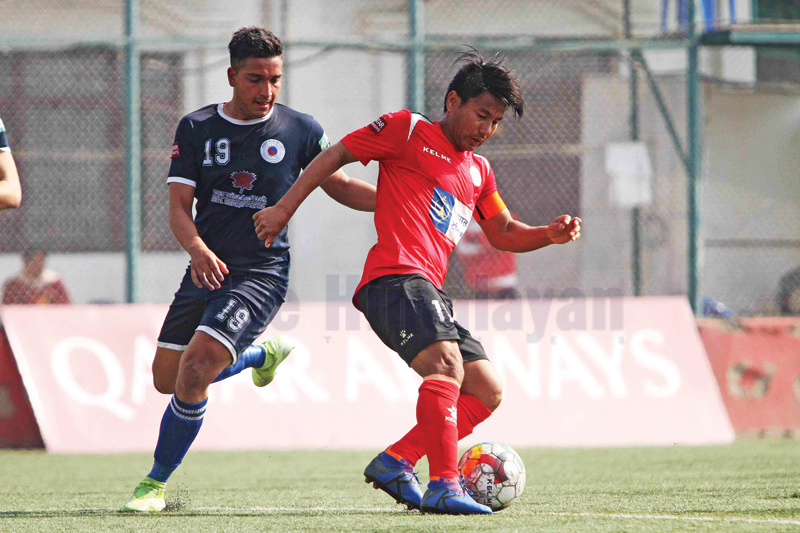 Ju Manu Rai (second from left) striker of Nepal Police Club dribbles the ball against Ashim Bhusal of Friends Club during their Qatar Airways Martyr's Memorial A Division League match at ANFA grounds in Lalitpur on Thursday. Photo: Udipt Singh Chhetry/THT