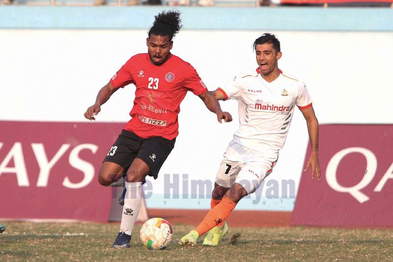Ranjit Dhimal (left) of Machhindra Club dribbles the ball against Top Bahadur Bista of Nepal APF Club during their  Qatar Airways Martyr's Memorial A Division League match at Dasharath Stadium in Kathmandu on. Saturday. Photo: Udipt Singh Chhetry/THT