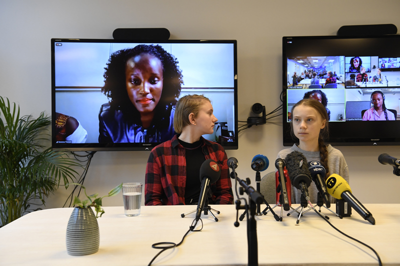 Climate activist Vanessa Nakate, left, speaks via video-link as Ell Ottosson Jarl and Greta Thunberg, right, also attend a press conference with climate activists and experts from Africa in Stockholm, Sweden, Friday Jan. 31, 2020. Ugandan climate activist Vanessa Nakate and peers from other African nations on Friday made an urgent appeal for the world to pay more attention to the continent that stands to suffer the most from global warming despite contributing to it the least. Photo: Pontus Lundahl/TT via AP