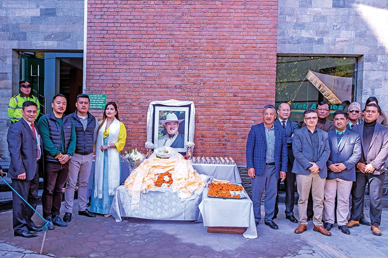 Family members of late Ang Tshiring Sherpa and staffers of Yeti Group participating in a programme held to observe Sherpau2019s death anniversary, in Kathmandu, on Thursday. Photo: THT