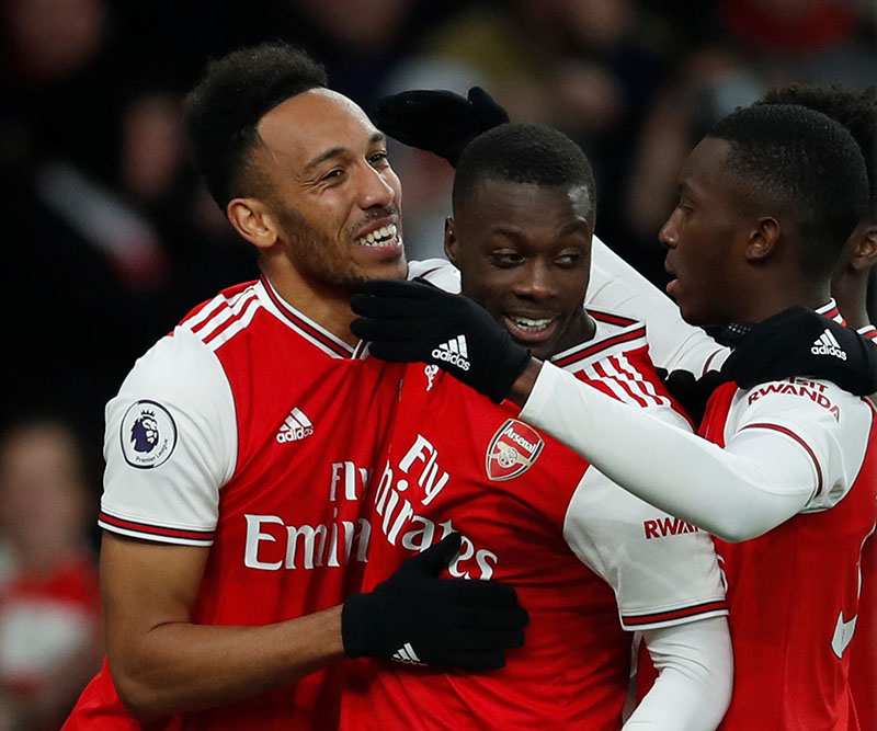 Arsenal's Pierre-Emerick Aubameyang celebrates scoring their third goal with Nicolas Pepe and Eddie Nketiah during the Premier League, match between Arsenal and Everton, at Emirates Stadium, in London, Britain, on February 23, 2020. Photo: Reuters