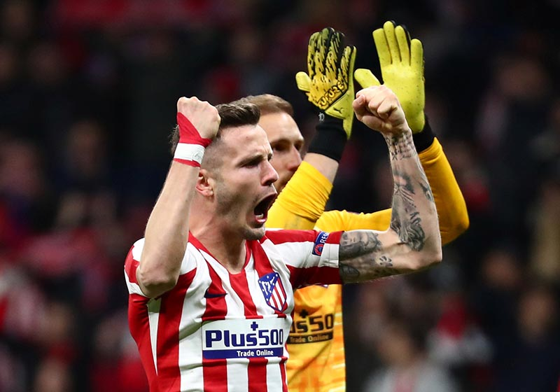 Atletico Madrid's Saul Niguez and Jan Oblak celebrate after the match during the Champions League Round of 16 First Leg match between Atletico Madrid and Liverpool, at Wanda Metropolitano, in Madrid, Spain, on  February 18, 2020. Photo: Reuters