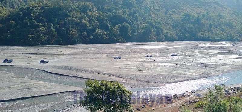 Tractors being used to ferry illegally extracted river-borne materials in Budhiganga Municipality, Bajura, on Tuesday, February 11, 2020. Photo: THT