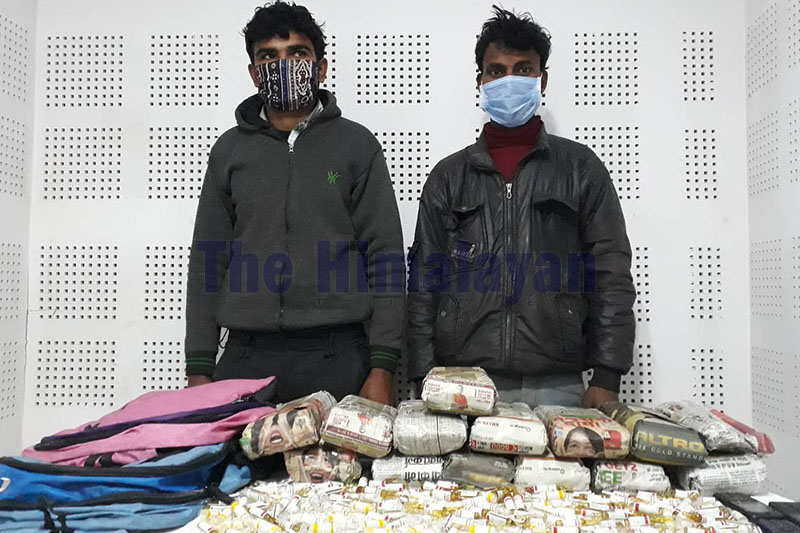 Police making public two suspects along with seized illegal drugs at District Police Office, Bara, on Thursday, February 13, 2020. Photo: Puspa Raj Khatiwada/THT