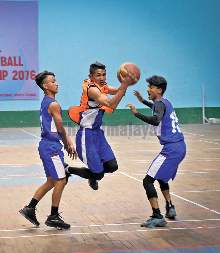 Action in the match between New Zenith and Ramechhap (centre) during the IIMS fifth Under-18 National Basketball Tournament in Kathmandu on Sunday. Photo: THT