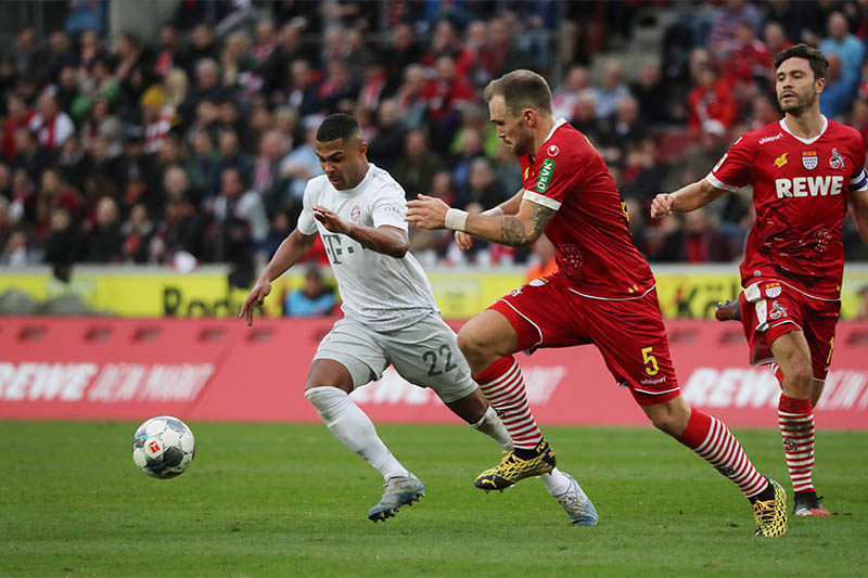 Bayern Munich's Serge Gnabry in action with FC Cologne's Rafael Czichos. Photo: Reuters