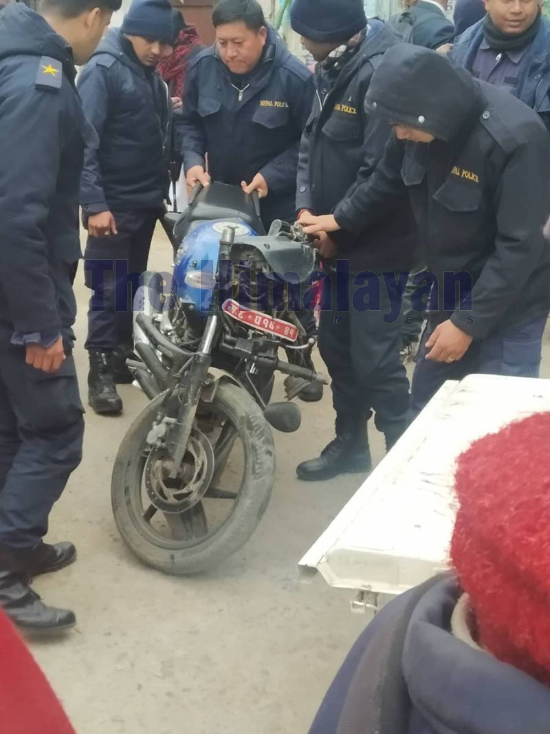 Police personnnel observe damaged motorbike after an accident in Tanahun, on Thursday, February 13, 2020. Photo: Madan Wagle/THT