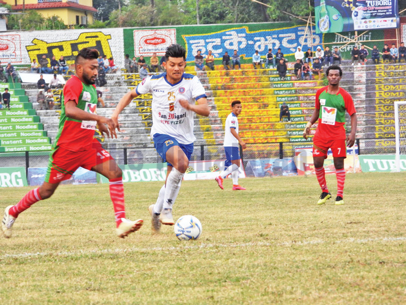 Bimal Gharti Magar (right) of San Miguel Machhindra Club vies for the ball with Sunday FC player during the 22nd Budhasubba Tuborg Gold Cup match in Dharan on Tuesday. Photo: THT