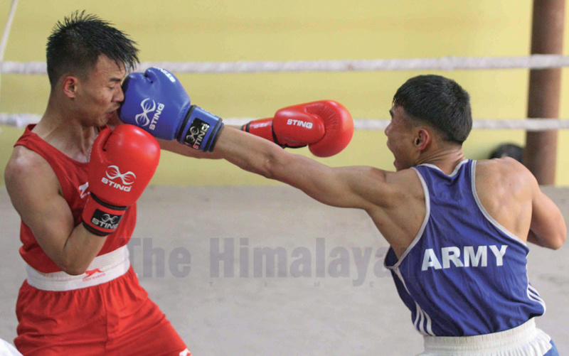Purna Sunuwar (right) of Tribhuvan Army Club fights against Buddha Gyamjo Lama of Lalitpur in men's 57 kg final bout during boxing selection tournament finals at International Sports Complex, Satdobato in Lalitpur on Thursday. Photo: Udipt Singh Chhetry/THT