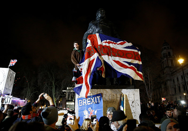 People celebrate at the statue of Winston Churchill as Britain leaves the EU on Brexit day in London, Britain, January 31, 2020. Photo: Reuters