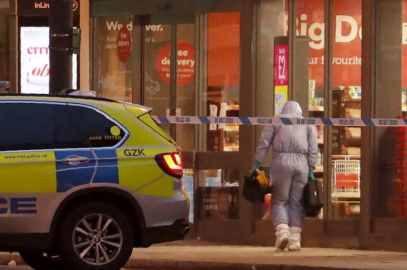 A police forensic officer works near the scene after a stabbing incident in Streatham London, England, Sunday, Feb 2, 2020. Photo: AP