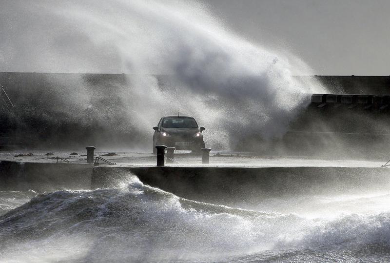 Waves lash the coast on the Ayrshire coast at Ardrossan, Scotland, Sunday, Feb 9, 2020. Photo: Andrew Milligan/PA via AP