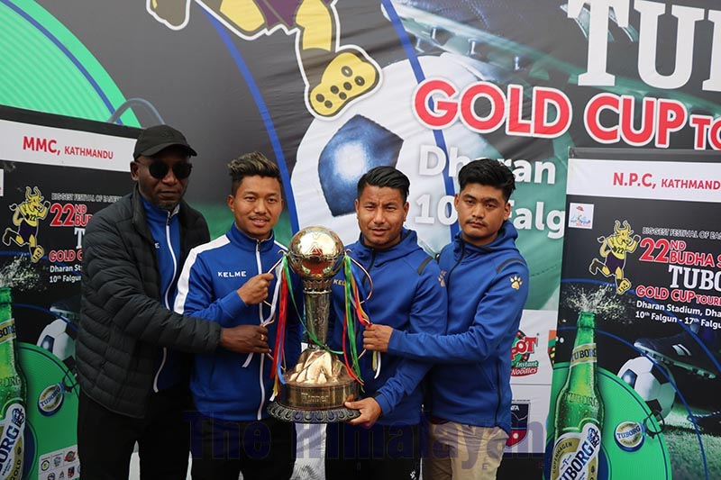Coaches and skippers of Nepal Police Club and NOC Manang Marshyangdi Club hold the trophy in Dharan on Friday, on the eve of the Budhasubba Tuborg Gold Cup final match. Photo: Santosh Kafle/THT
