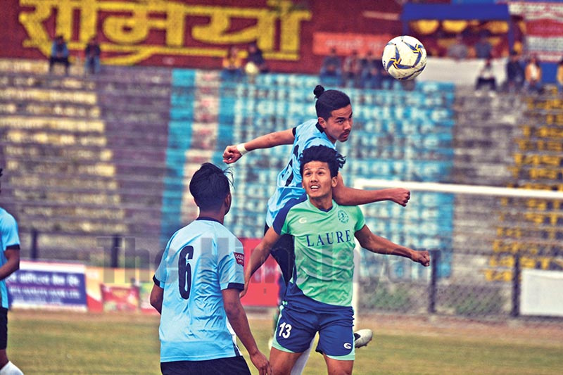 Pujan Uaprkoti of NOC Manang Marshyangdi Club heads the ball during the 22nd Budhasubba Tuborg Gold Cup match against Belbari in Dharan, on Monday. Photo: THT