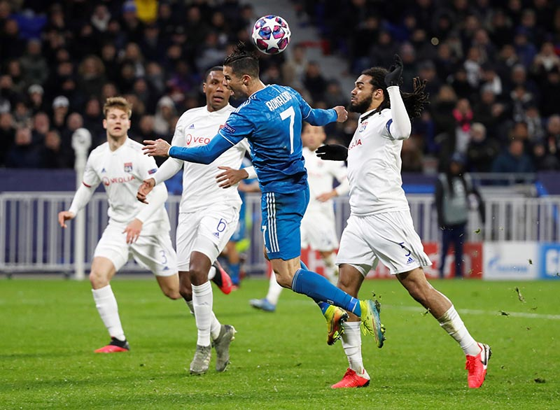 Juventus' Cristiano Ronaldo in action with Olympique Lyonnais' Jason Denayer during the Champions League  Round of 16 First Leg match between Olympique Lyonnais and Juventus, at Groupama Stadium, in Lyon, France, on February 26, 2020. Photo: Reuters