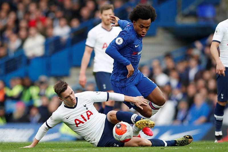 Chelsea's Willian in action with Tottenham Hotspur's Giovani Lo Celso. Photo: Reuters